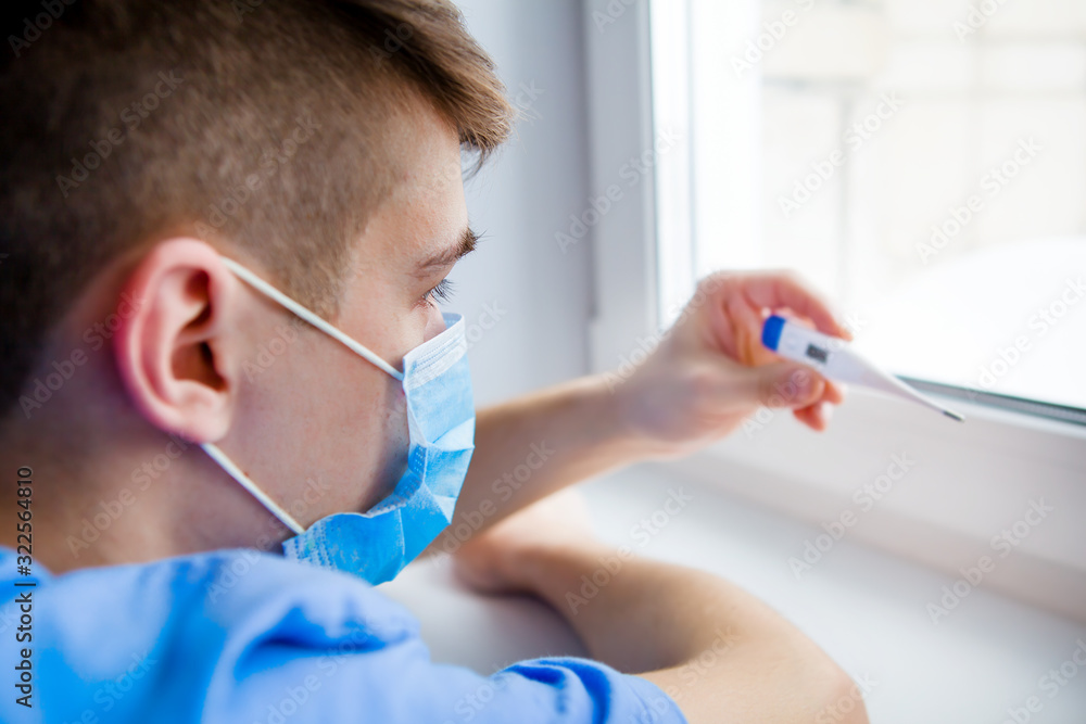 Fototapeta Young Man with a Thermometer