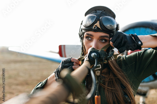 close-up of an aviator wearing a special headgear to protect ears with glasses, Canvas Print
