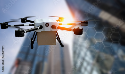 Obraz Delivery drone used to transport packages fly on city background blurred, technology society 5.0 and Smart city communication network 5g concept.sustainability & environmental harmony.3d rendering. - fototapety do salonu