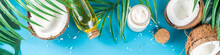 Coconut Oil In Glass Jar With  Tropical Leaves And Fresh Coconut. Organic Mct Oils Concept. Turquoise, Aquamarine Background