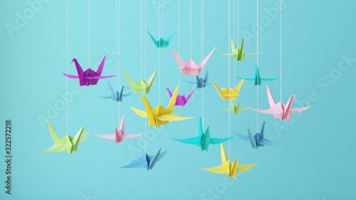 Obraz na plátně 3D illustration-Colorful pastel origami paper cranes on blue background