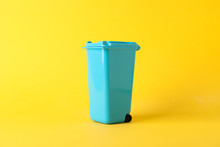 Blue Recycle Bin On Yellow Background, Space For Text