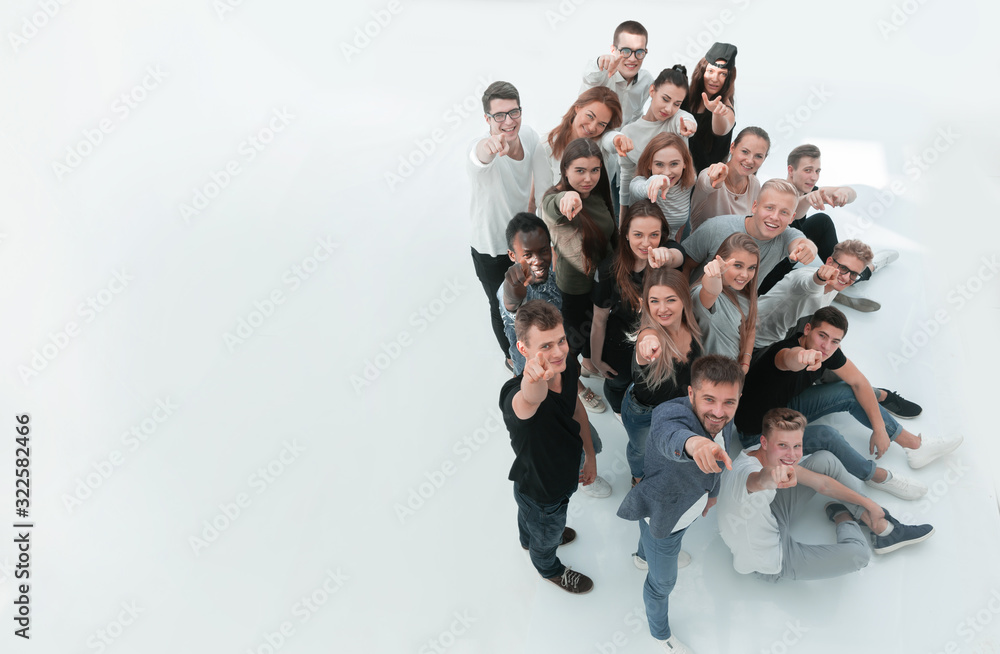 Fototapeta top view. group of happy young people looking at the camera