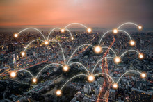 Network Connection Curve Light Line At The Top Of The Building And Light Point All Connection In Panoramic Metropolis Cityscape With Transportation Around Area In Orange Twilight Time. Clipping Path.