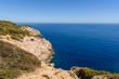 Rocky coast with blue sea. Cala Ratjada , north-east coast of Majorca. Spain