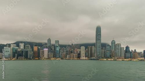 Obraz na plátně Hong Kong time lapse 4K, city skyline night to day timelapse at Victoria Bay Hon