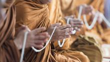 Buddhist Monk Praying Hands In Buddhism Tradition Ceremony.