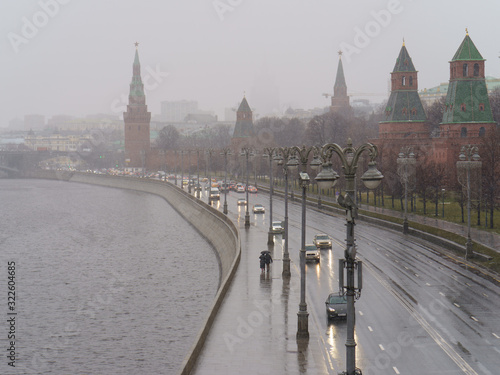 Moscow Kremlin wall and road near it at rainy spring day Canvas Print