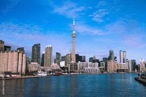 Panorama of Toronto skyline with the famous CN Tower under blue skies