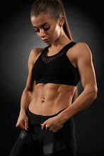 Fitnesswoman Showing Muscular Abs.