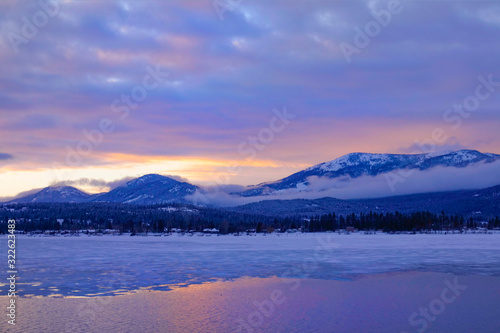 Picturesque view of Lake Pend Oreille and adjacent mountains at golden sunrise Wallpaper Mural