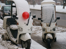 Photograph Of Motor Scooters Deliverers Of Food In The Snow With A Red Balloon. Valentine's Day Gift. Two Lovers.