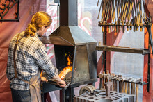 Male Blacksmith Working In Wor...