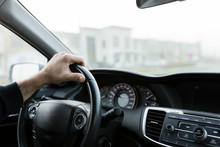 Male Hand On Black Steering Wh...