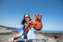 A Woman And A Boiled Lobster
