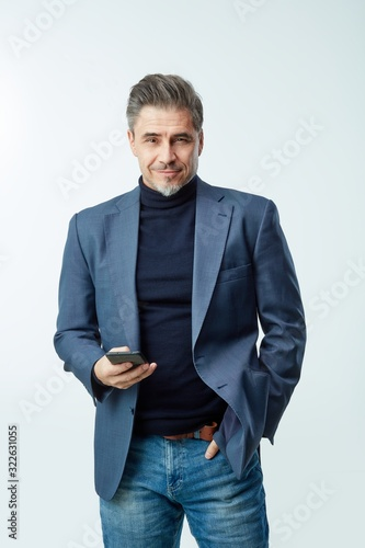 Happy older businessman in business casual