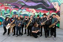 High School Jazz Band Musicians In Front Of Urban Graffiti Mural