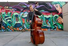 High School Jazz Band Musician Playing Double Bass By Graffiti