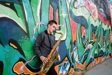 High School Jazz Band Musician Playing Saxophone By Graffiti