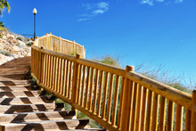 Walkway And Wooden Fence Along...