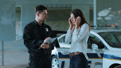 Handsome policeman interrogates a woman in an incident arrest criminal enforceme Canvas Print