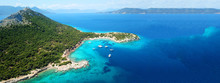Aerial Drone Ultra Wide Photo Of Paradise Small Island Of Moni Visited By Sail Boats And Yachts With Turquoise Clear Seascape, Aegina Island, Saronic Gulf, Greece
