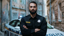 Close Up Serious Young Man Cops Hold Pistol Stand Near Patrol Car Look At Camera Enforcement Officer Police Uniform Auto Safety Security Communication Control Policeman Portrait Slow Motion
