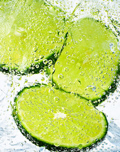 Close Up Of Lime Slices In Water