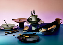 Studio Shot Of Modern Plates, Cups Ant Cutlery