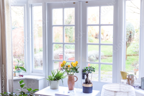 Stylish room interior with french doors and light neutral colours in a modern ho Canvas Print