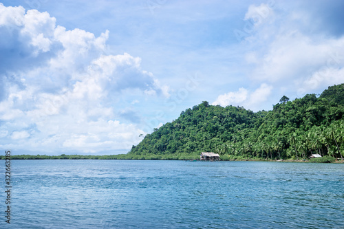 Beautiful landscape with blue sea, tropical islands and fishing houses on stilts in mangrove lagoon, Siargao Island, Philippines Canvas Print