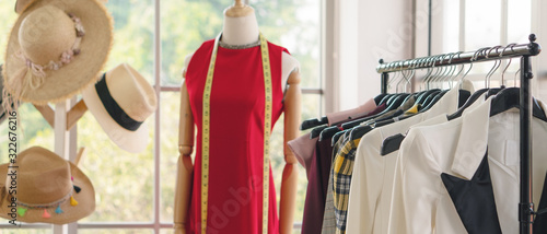 Fotomural woman cloth hanging on rack to show at fashion retail store