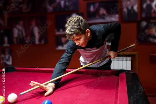 Tela Boy plays billiard or pool in club