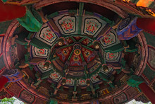 Colorful Paintings On The Ceiling Of An Altar Of Buddhist Temple