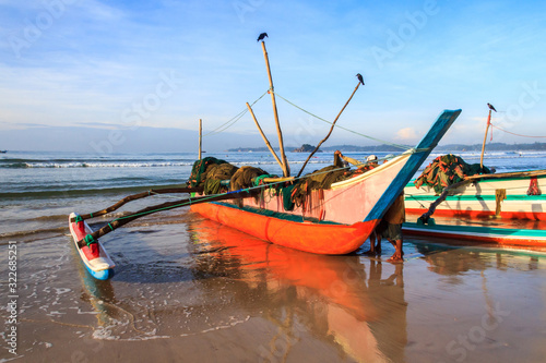 Traditional fishing boat on beach, Sri Lanka Wallpaper Mural