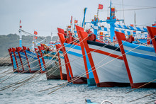 Vibrant Asian Fishing Boats In The Port