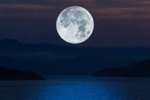 Full Moon Over Lake At Night.