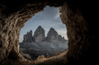 canvas print picture - Dark landscape of maountains seen from the cave