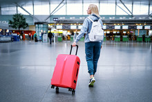 Traveling Concept. Young Woman In Casual Wear Standing In International Airport Terminal.