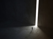 Man Walking In A Narrow Light ...