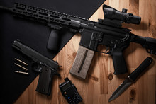 Weapons And Military Equipment For Army, Assault Rifle Gun And Pistol On Wooden Background.