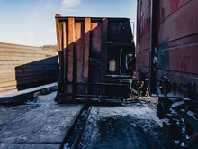 The Railway Gondola Car Fell On Its Side During Unloading. Winter. Sunny Day. Crash.