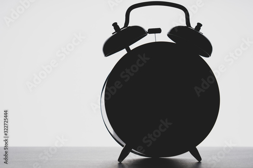 Obraz outline of the alarm clock in the dark, toning, selective focus, space for text on the left - fototapety do salonu