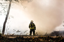 Firefighters Extinguish A Fire...