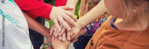 Canvastavla hands of children, many friends, games. Selective focus