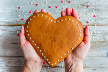 Homemade Gingerbread Heart On A Wooden Background. Valentine's Day.