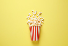 Delicious Popcorn On Yellow Background, Top View