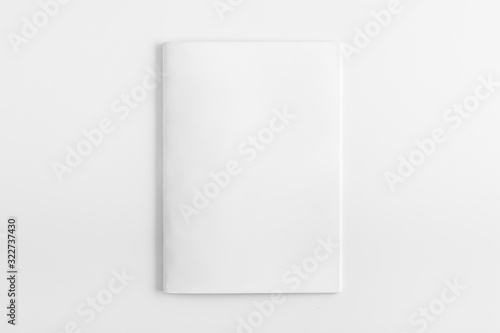 Photo Blank Square Magazine with soft shadows isolated on white as template for designers presentation, showcase etc