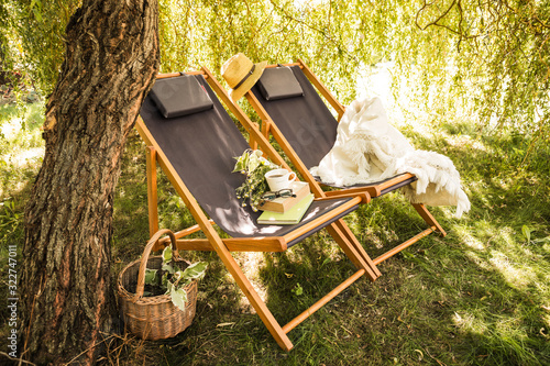 Foto Two wooden deck chairs - summer outdoor leisure in the garden