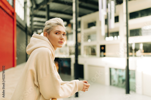 Blond young woman with short hair indoors #322766232
